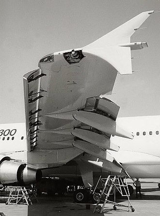 Flap (aeronautics) - The position of the trailing edge flaps on a typical airliner (here, an Airbus A310). In this picture, the flaps are extended; note also the extended leading edge slats.