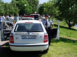 Law enforcement in Slovakia - Slovak Railway policewoman standing next to her vehicle in 2005
