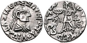 "Zoilos II - Coin of king Zoilos II (55–35 BCE), as a balding man. Obv: Bust of Zoilus II (or Zoilus III) with Greek legend ΒΑΣΙΛΕΩΣ ΣΩΤΗΡΟΣ ΖΩΙΛΟΥ (BASILEOS SOTEROS ZOILOU) ""Of King Zoilos the Saviour"". Rev: Athena advancing left, with thunderbolt and shield covered with aegis (type of Menander I). Kharosthi legend: MAHARAJASA TRATARASA JHOILASA ""King Zoilos the Saviour""."