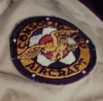 """""""Consolidated Aircraft"""" patch detail, A mechanic greasing a landing gear (cropped).jpg"""