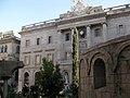 18 Pessebre romànic, al fons l'Ajuntament.jpg