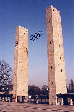 The stadium entrance in 1993. There was origionally a swatska on the right column parallel to that of the clock on the left but it was later removed.