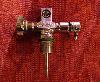 "Diving regulator - A 1964 scuba cylinder valve with reserve, commonly known as a ""type J"" valve. The inlet is threaded 3/4""-14 NPSM and the outlet is a standard yoke type."