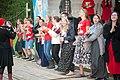 2017-07-16 19-16. Волонтёры возле сцены взялись за руки.jpg