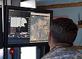 20th SUPCOM soldiers roll through AGSCP robot testing at Muscatatuck 120806-A-AC168-025.jpg