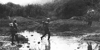Operation Prairie - 3/3 Marines crossing a stream west of Cam Lo in March 1967
