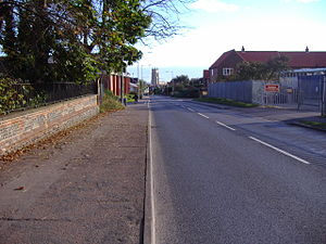 A148 road - The road drops down into the heart of Cromer
