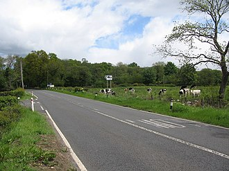 A811 road - A view looking northeast along the A811 Old Military Road at the junction to Lagganbeg