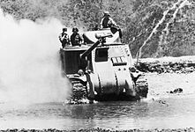 A British Lee tank crosses a river north of Imphal to meet the Japanese advance in Burma, 1944. IND3468.jpg
