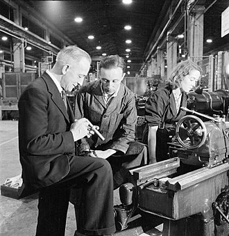 Union representative - A British shop steward discusses an issue with a foreman during WWII