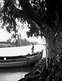 A GHAFFIR STANDING GUARD ON THE YARKON RIVER. שוטר עומד על סירה בנהר הירקון.D403-157.jpg