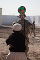 A boy throws a soccer ball to a U.S. Soldier outside a new school in Ananzai village, Kandahar province, Afghanistan, Dec. 26, 2011, before the school's opening ceremony 111226-A-VB845-022.jpg