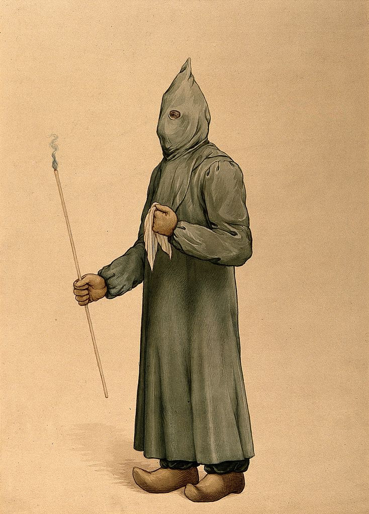 734px-A_physician_wearing_a_plague_preventive_costume_in_Marseille_Wellcome_V0010643.jpg