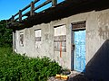 Abandoned building with Chinese Nationalist patriotic words on Orchid Island 20100911.jpg