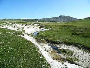 Machair - A stream cutting through the machair highlights a sandy composition