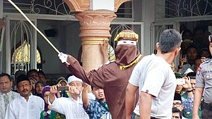 Islamic criminal law in Aceh - A convict receiving a caning sentence in Banda Aceh in 2014. Caning is one of the controversial provisions of Islamic criminal law in Aceh.