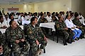 Afghan doctors and nurses listen as Afghan National Army (ANA) Gen. Mohammad Wardak, not shown, the surgeon general for the ANA, delivers remarks while visiting the Kandahar Regional Medical Hospital in Kandahar 130819-A-VM825-079.jpg