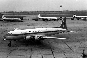 History of Heathrow Airport - Heathrow in the 1960s with a Sabena Douglas DC-6 at front and with Vickers Viscounts at the rear