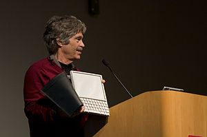 Laptop - Alan Kay holding the mockup of his Dynabook concept (photo: 2008 in Mountain View, California)