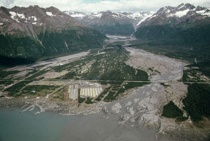 Valdez, Alaska - The Valdez townsite, abandoned and relocated following the 1964 earthquake, was being used as a pipe yard for the construction of the Trans-Alaska Pipeline System, as shown in this 1974 photo
