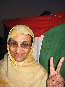 "Aminatou Haidar making a ""V-for-victory"" sign"