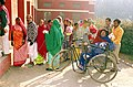 An handicapped lady arrives at a Polling booth to cast her vote during Assembly Elections of Delhi on December 1, 2003 (Monday).jpg