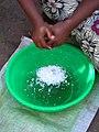 Ana Maria grating coconut (Inhambane Province, Mozambique).jpg