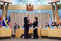 Arctic Council Chairman Leona Aglukkaq of Canada Passes a Ceremonial Gavel to Secretary Kerry.jpg