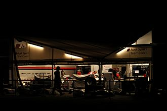 Joest Racing - The Joest Racing team at work on their cars before dawn for the 2012 12 Hours of Sebring.