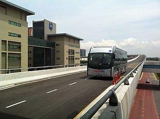 BRT Sunway Line - BYD battery-powered electric bus approaching SunU-Monash station