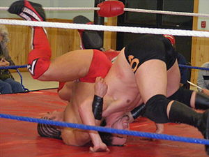 A backslide pin in professional wrestling
