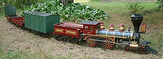Backyard railroad - A backyard railroad, with a 4-4-0 locomotive in 1:8 scale, on a portable track.