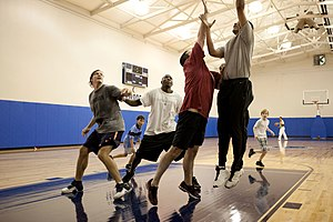 President Barack Obama plays basketball with s...