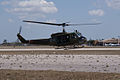 Bell UH-1H Iroquis Huey Coming to Land 05 TICO 13March2010 (14598768442).jpg