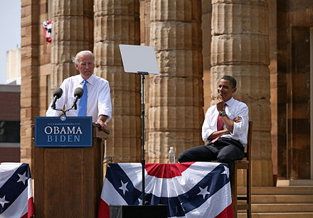 Joe Biden speaking at the August 23, 2008 vice presidential announcement in Springfield, Illinois, while presidential nominee Barack Obama listens Biden Obama 3b.jpg