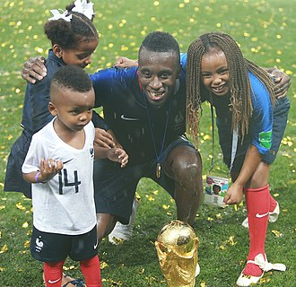 Blaise Matuidi - Matuidi and his children posing with the FIFA World Cup Trophy