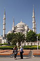 Blue Mosque Two Tourists Wikimedia Commons.JPG