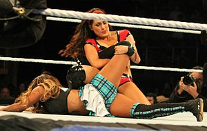 Boston crab - Brie Bella performing a single leg Boston crab on Cameron