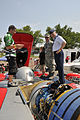 Brig. Gen. McGoff gets top-side view of U-6 Oh Boy! Oberto hydroplane 120708-Z-II695-055.jpg