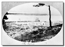 black and white postcard of the site, with the sea in the background