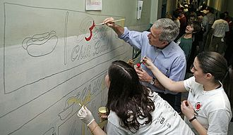 Cardozo Education Campus - Then-U.S. President George W. Bush helping to paint a mural of local landmark Ben's Chili Bowl with City Year Americorps members at Cardozo.