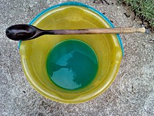 blue-green liquid in a bucket
