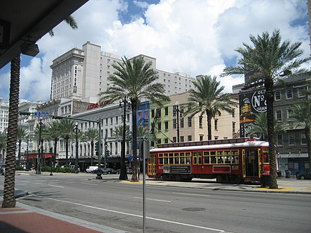 A New Orleans streetcar traveling down Canal Street Canal St NOLA CBD Sept 2009 St Charles Astor Redcar.JPG