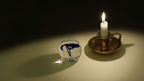 Candle light projected through a glass orb.jpg