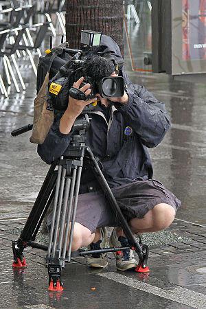 Network Ten - Ten News camera operator filming a traffic piece in Sydney by Vic Lorusso