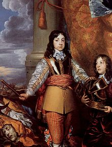 Charles as a boy with shoulder-length black hair and standing in a martial pose