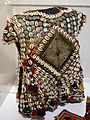 Child's tunic, Yomud Turkmen people, Northern Afghanistan , early to mid 20th century, wool, cotton, metal, cowrie shells, glass beads - Textile Museum of Canada - DSC00915.JPG