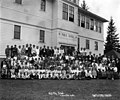 Children and teachers outside of the public school class, Hammond Lumber Company, Mill City, ca 1912-1934 (KINSEY 2336).jpg