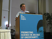 photo of Chris French presenting from podium at the World Skeptics Congress 2012 in Berlin