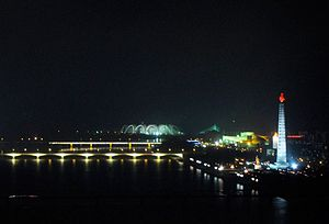 Ongryu Bridge - The Okryu Bridge (centre) at night, with the Juche Tower visible on the right